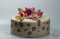Painted cake with matching sugarflowers