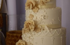 Gorgeous wedding cake all white with cascading flowers